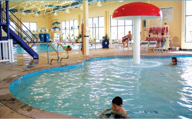 Photo of a public indoor pool environment.